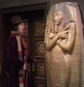 You and the doctor arrive in a room full of Egytological artifacts.