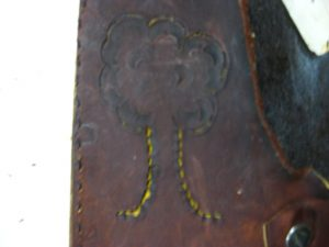Scrap leather cover with a nice little tree.