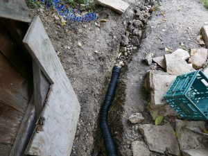 Connecting drain to water runoff pipe. The drain collects it, the runoff pipe takes it away from house.